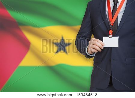 Businessman Holding Name Card Badge On A Lanyard With A National Flag On Background - Sao Tome And P
