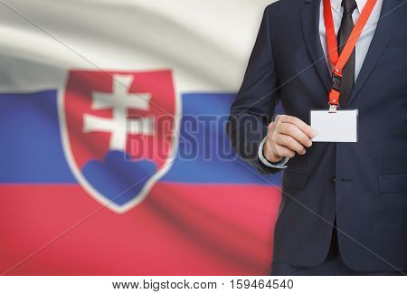 Businessman Holding Name Card Badge On A Lanyard With A National Flag On Background - Slovakia