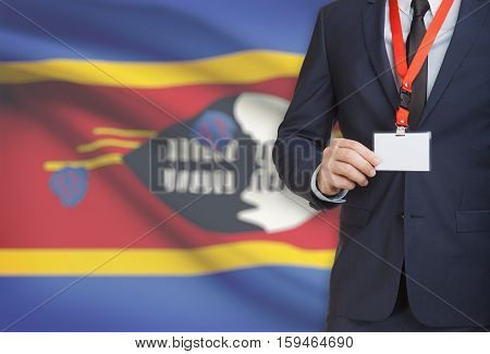 Businessman Holding Name Card Badge On A Lanyard With A National Flag On Background - Swaziland