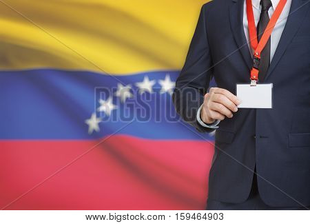 Businessman Holding Name Card Badge On A Lanyard With A National Flag On Background - Venezuela