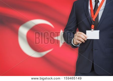 Businessman Holding Name Card Badge On A Lanyard With A National Flag On Background - Turkey