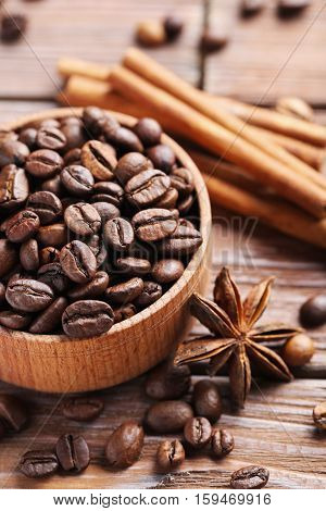 Roasted Coffee Beans On A Brown Wooden Table