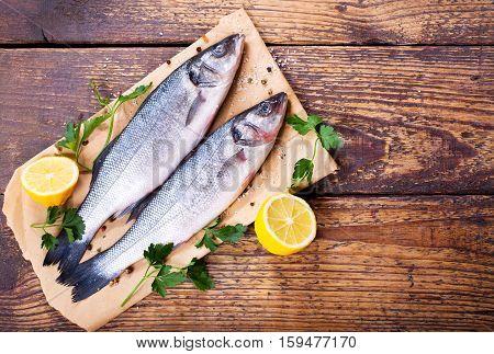 fresh fish sea bass on wooden table