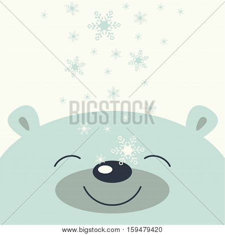 The cover design. Depicts face smile little polar bear on the white background. The falling snowflakes on the face polar bear.