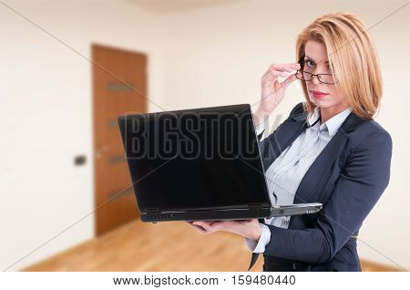 Attractive Female Agent Browsing On Laptop