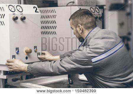 Worker Operating Welding Machine In Factory. Plastic Window And Door Industry Production.