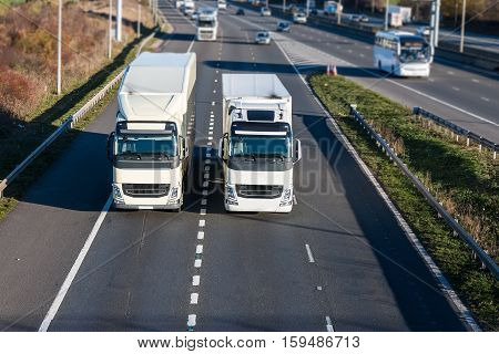 Two lorries driving side to side on the motorway junction
