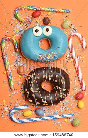 Funny Glazed Donuts On Orange Background