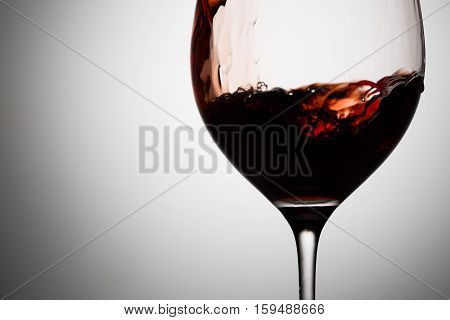 Red wine moves in glass. Beautiful natural image for your design needs