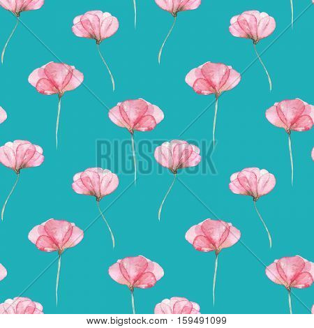Seamless floral pattern with pink tender flowers hand drawn in watercolor on a bright turquoise background