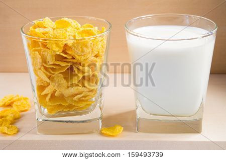 Cornflakes And Milk In Glass Cups