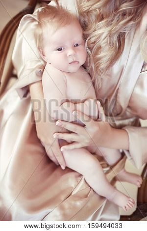 Closeup Portrait Of Baby Lying On Mother Hand. Mom And Child Concept. One Month Infant