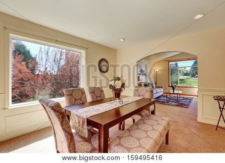Spacious Dining Room Interior With Upholstered Bench