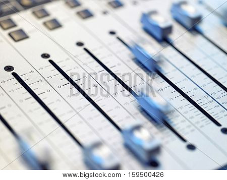 Closeup of mixing board in the recording studio