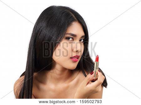 young beautiful asian woman applying makeup and cosmetic
