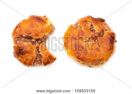 top view sweet mini chewy cakes or chickee cakes with one bited and one complete on white background