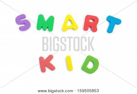 word of smart kid shaped by alphabet puzzles on white