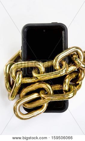 Cellphone locked up in a brass chain.