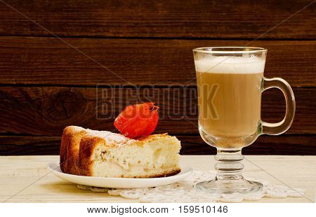 Cappuccino and apple pie on a wooden background