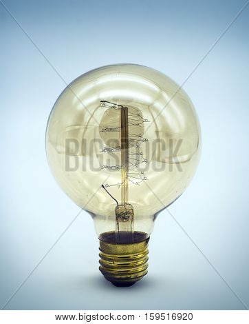 Incandescent lighted bulb with filaments and background