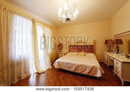 bedroom,bedding,textiles,curtains,bedspread,pillow,blanket,bed sheet ,lamp,floor lamp,chandelier,bed, dresser,mirror,light,bright, cottage, apartment , hotel,apartment,house,Studio, mansion,cottage,property, luxury,Royal, expensive,wealth, door, window,fl