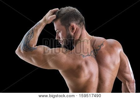 Handsome shirtless muscular man with jeans, standing, on black background