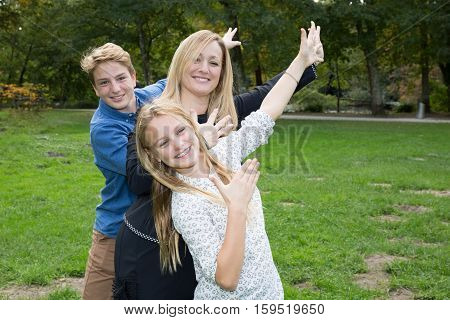the mother with blond teenager in park