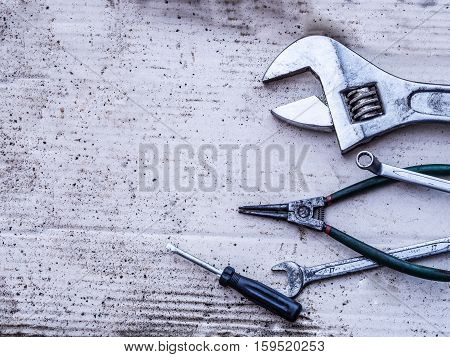 Old tools (wrench spanner screwdriver pliers). background.