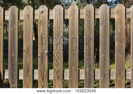 Wooden fence forbidding the access to nature.