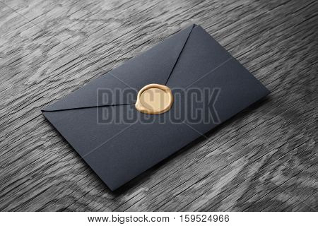 envelope with stamp on the wooden table