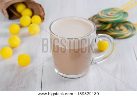 Lemon coffee shot close-up in the decoration on the wooden table
