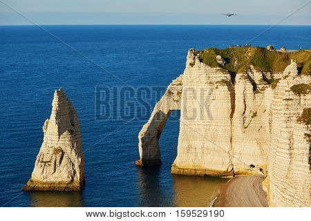 Scenic View Of Etretat Cliffs With Plane