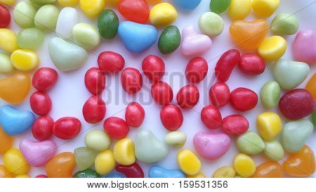 The word love of the colorful candy background