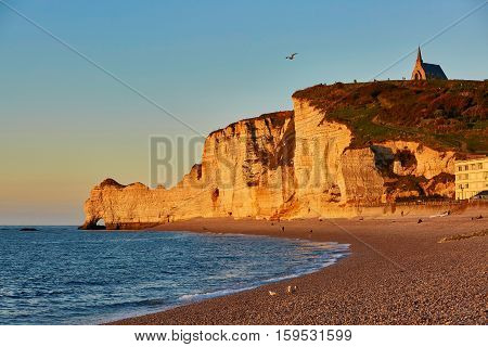 Scenic View Of Etretat Cliffs At Sunset