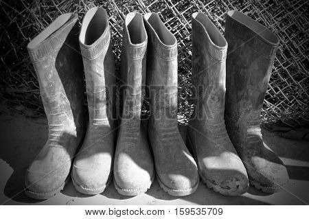 Three Pairs of Black Rubber Work Boots