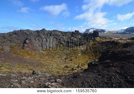 Iceland's Eldborg Crater with moss covered lava rock.