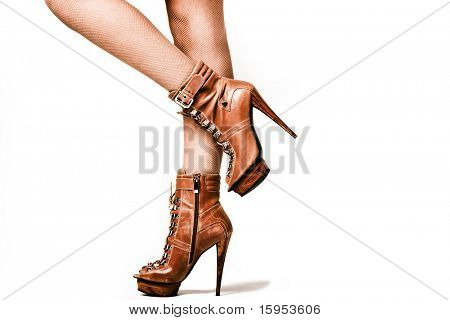 female legs in brown high heel platform shoes, studio shot