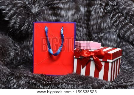 Paper Package And Box On Fur