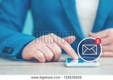 SMS business communication businesswoman using smartphone in the office