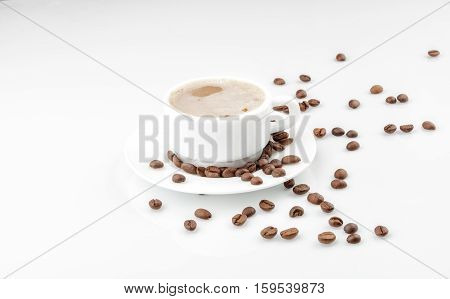 White Coffee Cup With Beans On White Background
