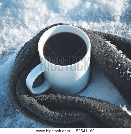 one Cup of coffee surrounded the warm scarf