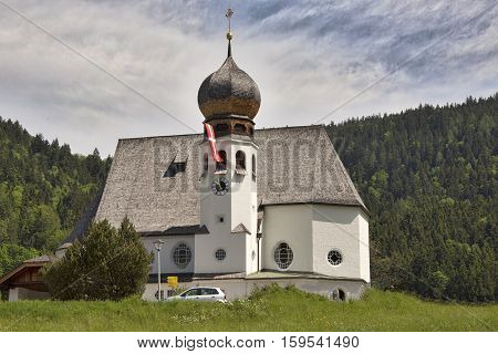 Church in Oberau, Germany. Has single spire with onion dome.