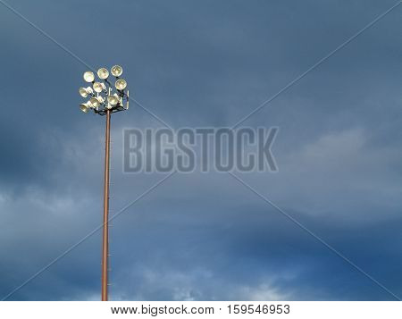 Light Tower- Outdoor sports lighting tower and cloudy blue sky.