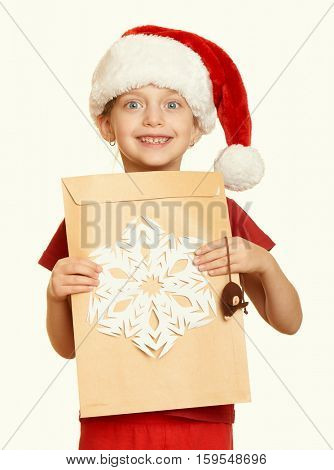 girl in red hat with letter to santa - winter holiday christmas concept, yellow toned