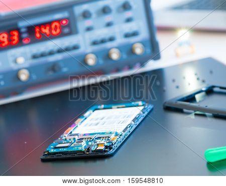 Repairing Smart Phone on Desk, Selective Focus