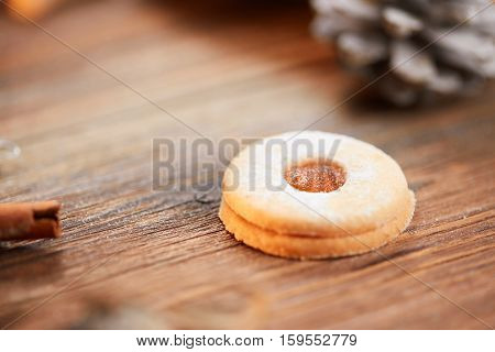 Single christmas cookie on a brown wooden table