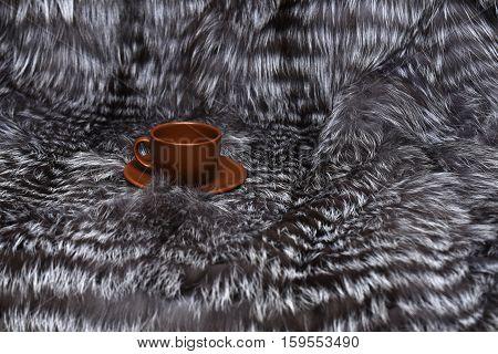 Brown Coffee Cup On Fur