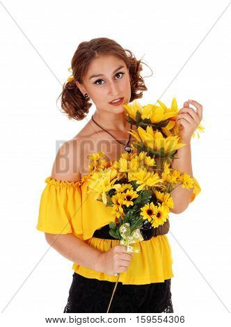 Gorgeous young woman in a yellow blouse holding a bunch of sunflowers smiling standing isolated for white background.