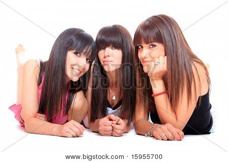 Group of three girls laying on the floor