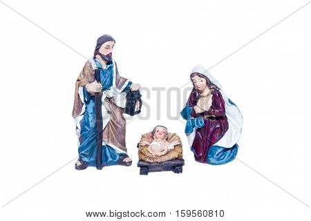 Figurines of the nativity on a white background